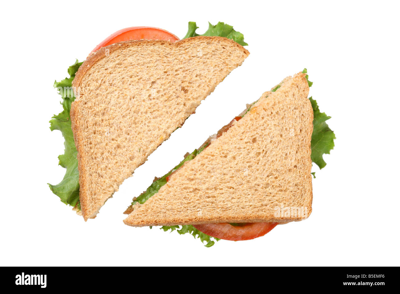 Sandwich cut in half cutout on white background - Stock Image