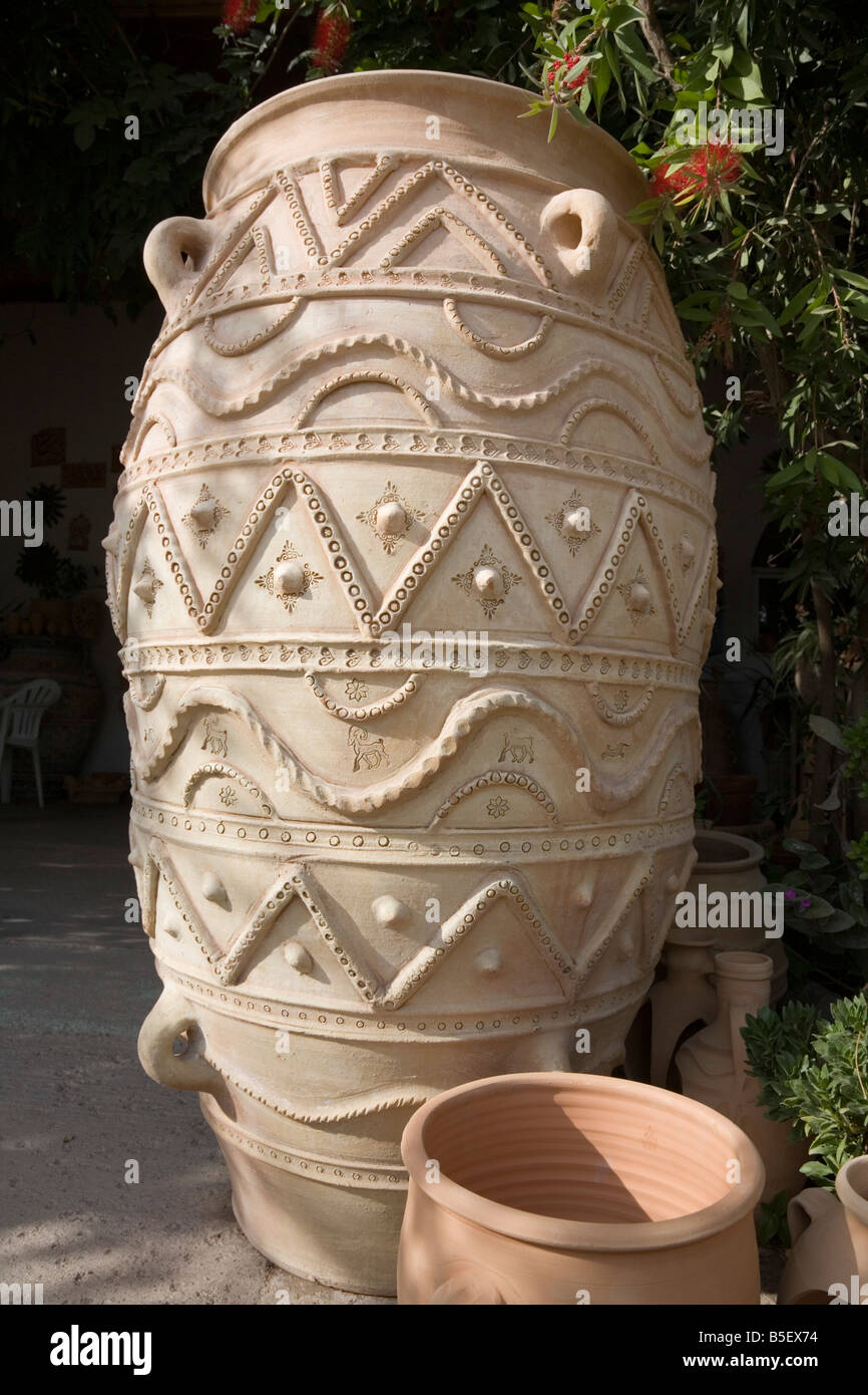 Reproduction of a pithos plural pithoi an ancient Greek storage jar made at the Ploumakis pottery in Thrapsano Crete - Stock Image