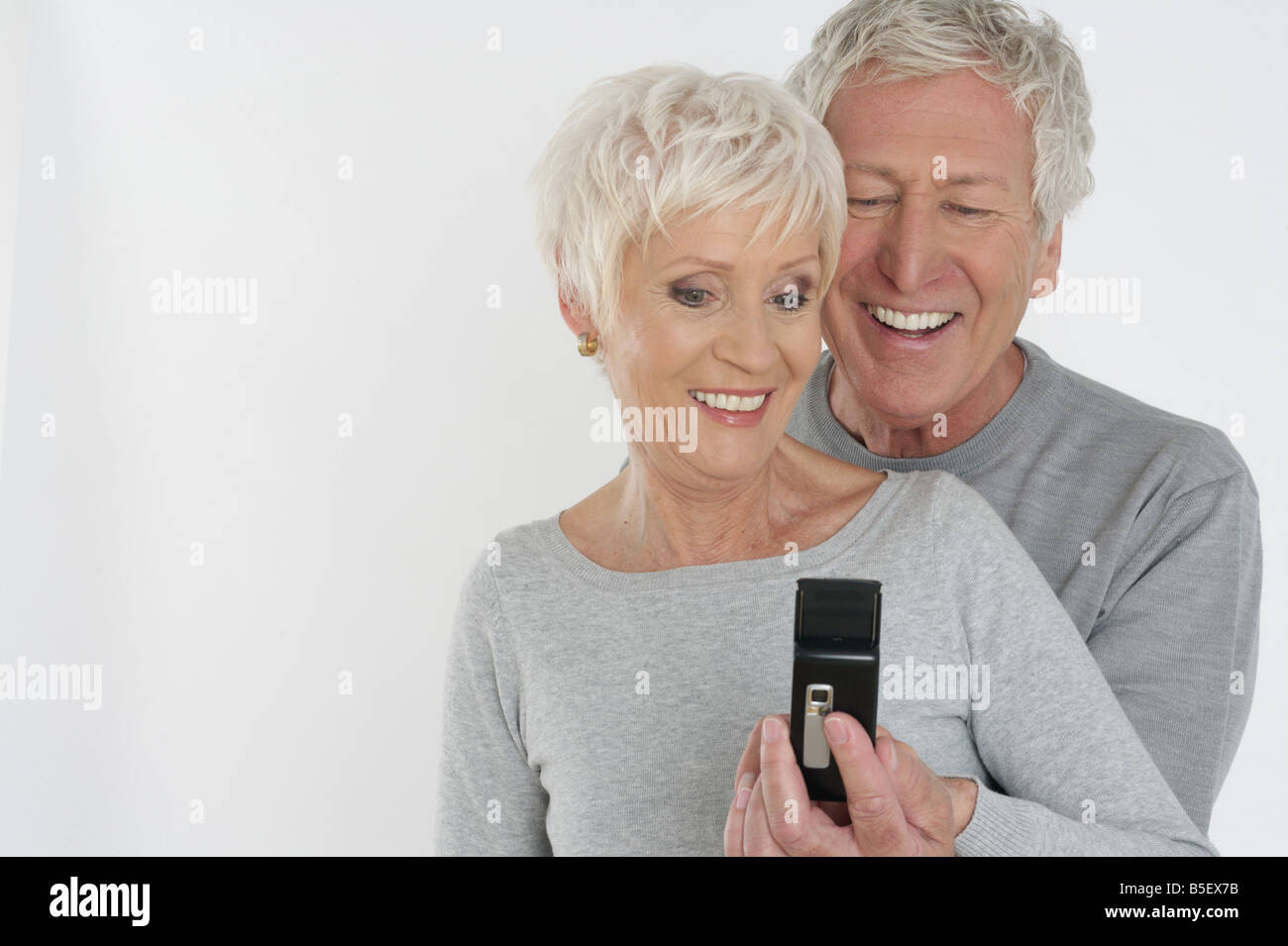 Old couple with a cellphone - Stock Image
