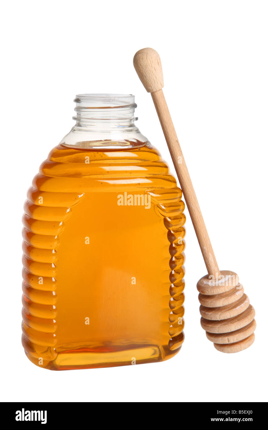 Honey container and drizzler cutout on white background - Stock Image