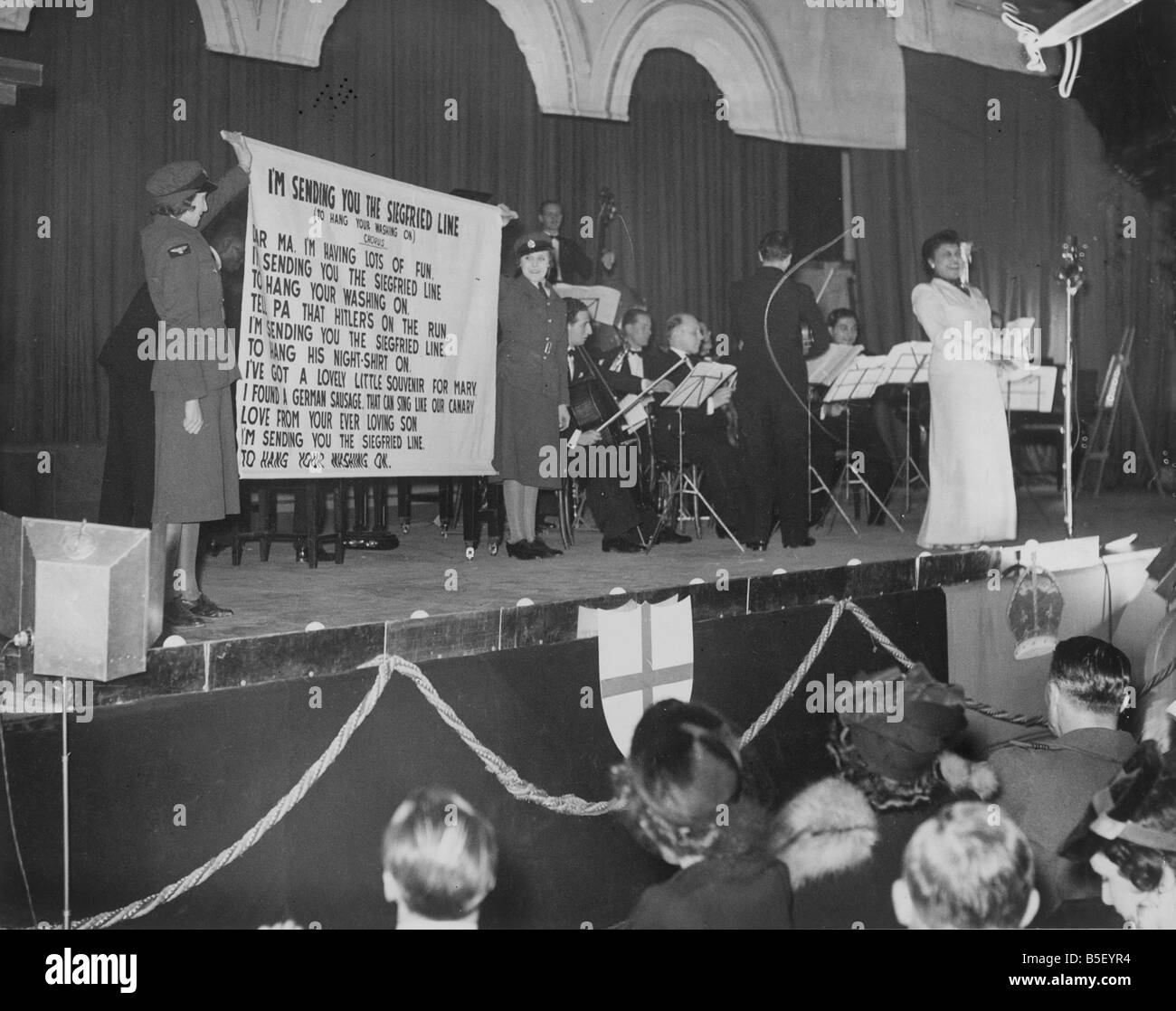 Scene at an RAF Variety concert at Adelaide Hall showing a singer performing the song Hang Out Your Washing On TheStock Photo