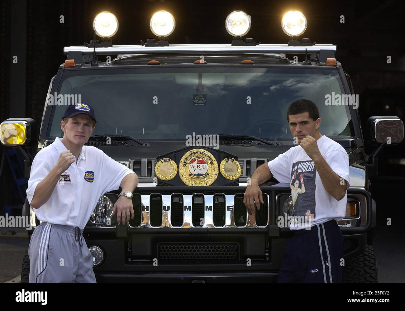 Ricky Hatton and Aldo Rios seen here standing in front of Hummvee car Hummer to promote thir Light Welterweight - Stock Image