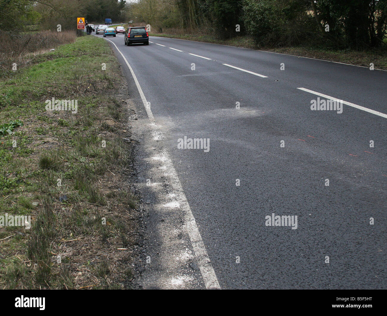 The scene of the accident with debris visible - Stock Image