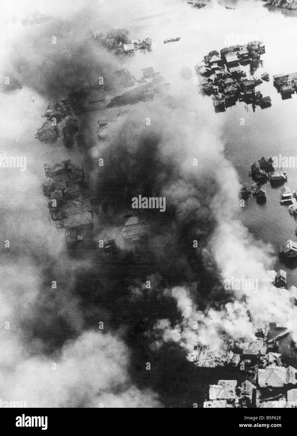 Smoke rises from the town of Brunei in British North Borneo after an attack by RAAF Beaufighters and Liberators - Stock Image