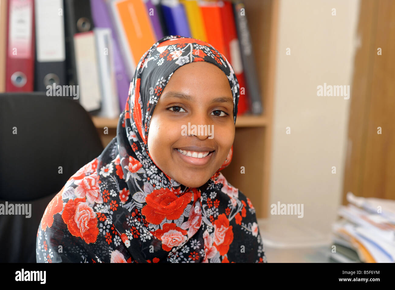 A portrait of a young Somalian Refugee working in a clerical job, Bolton - Stock Image