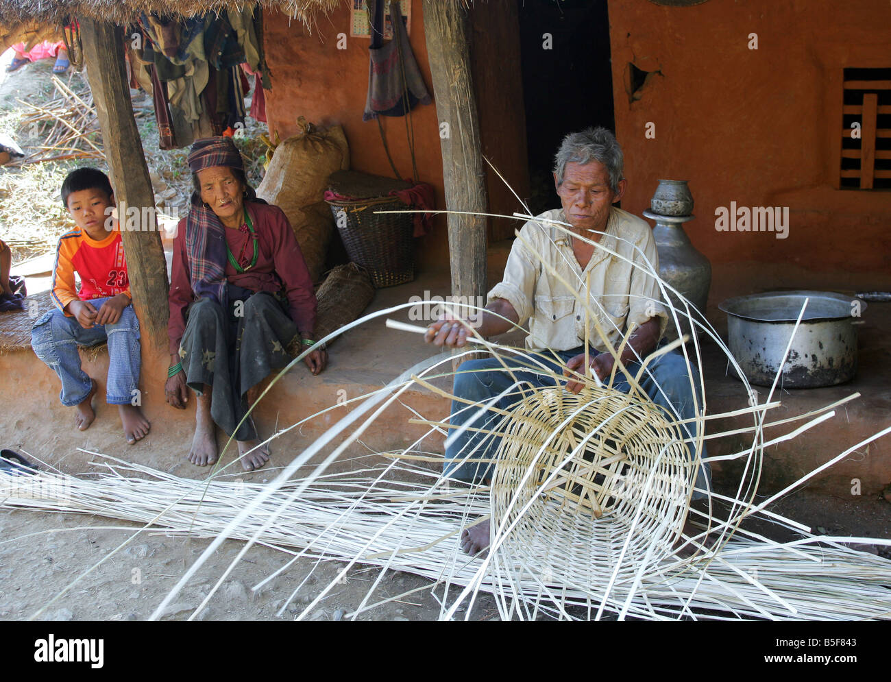 Nepal: Wicker worker in a mountain village in the Himalaya mountains - Stock Image