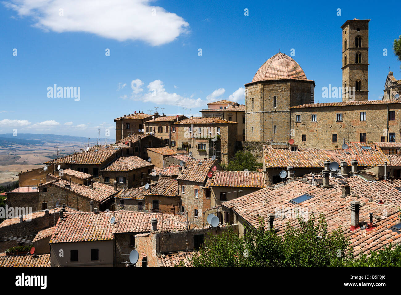 View over the rooftops towards the Duomo and Campanile, Hill Town of Volterra, Tuscany, Italy - Stock Image