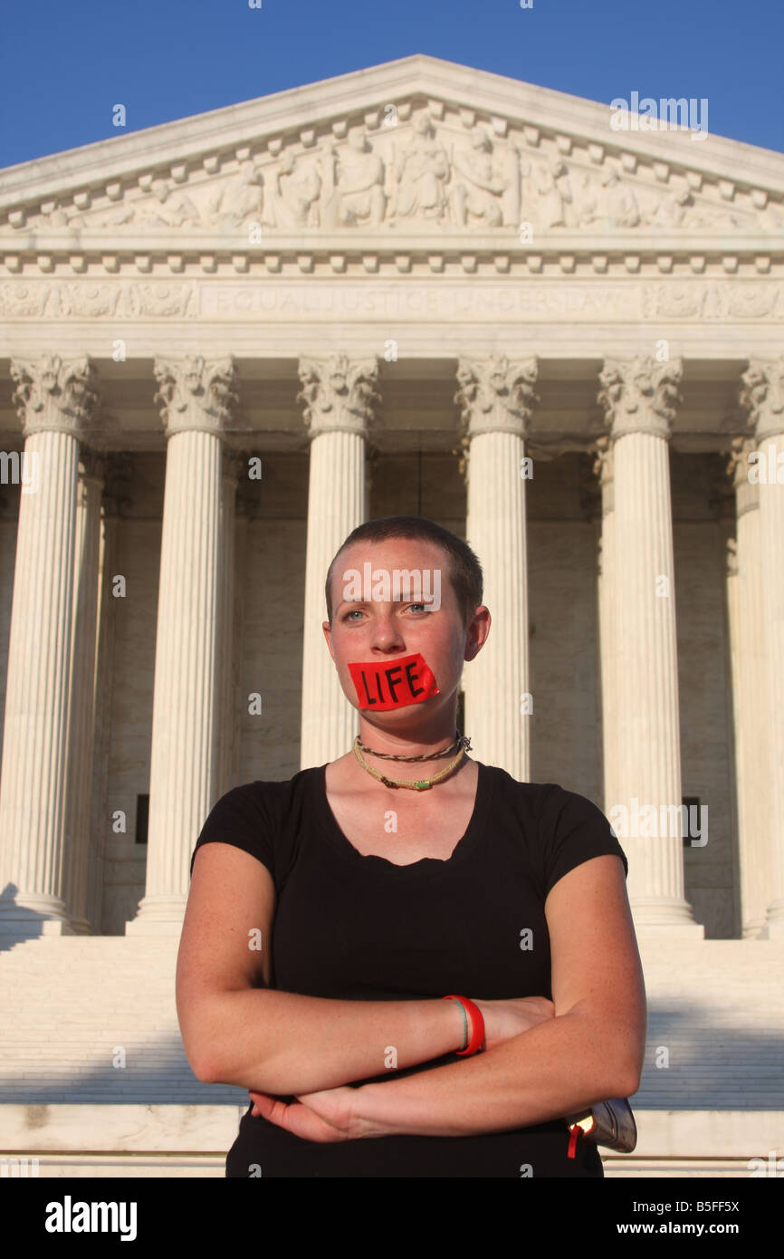 A pro-life protester stands in front of the U.S. Supreme Court. - Stock Image