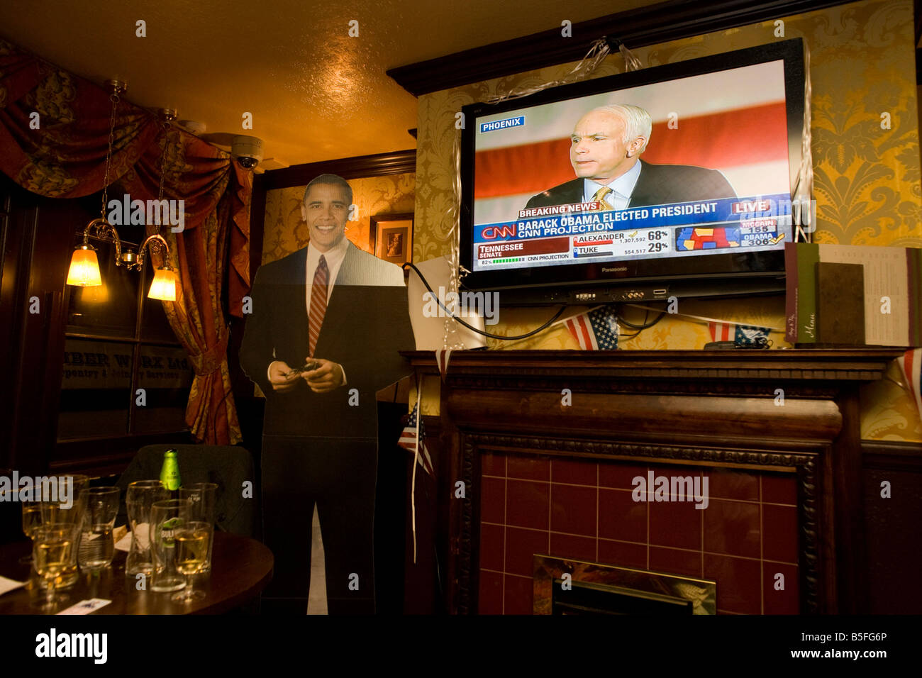 Senator John McCain concedes defeat by life-sized cut-out of Barack Obama after overnight 2008 election party in - Stock Image