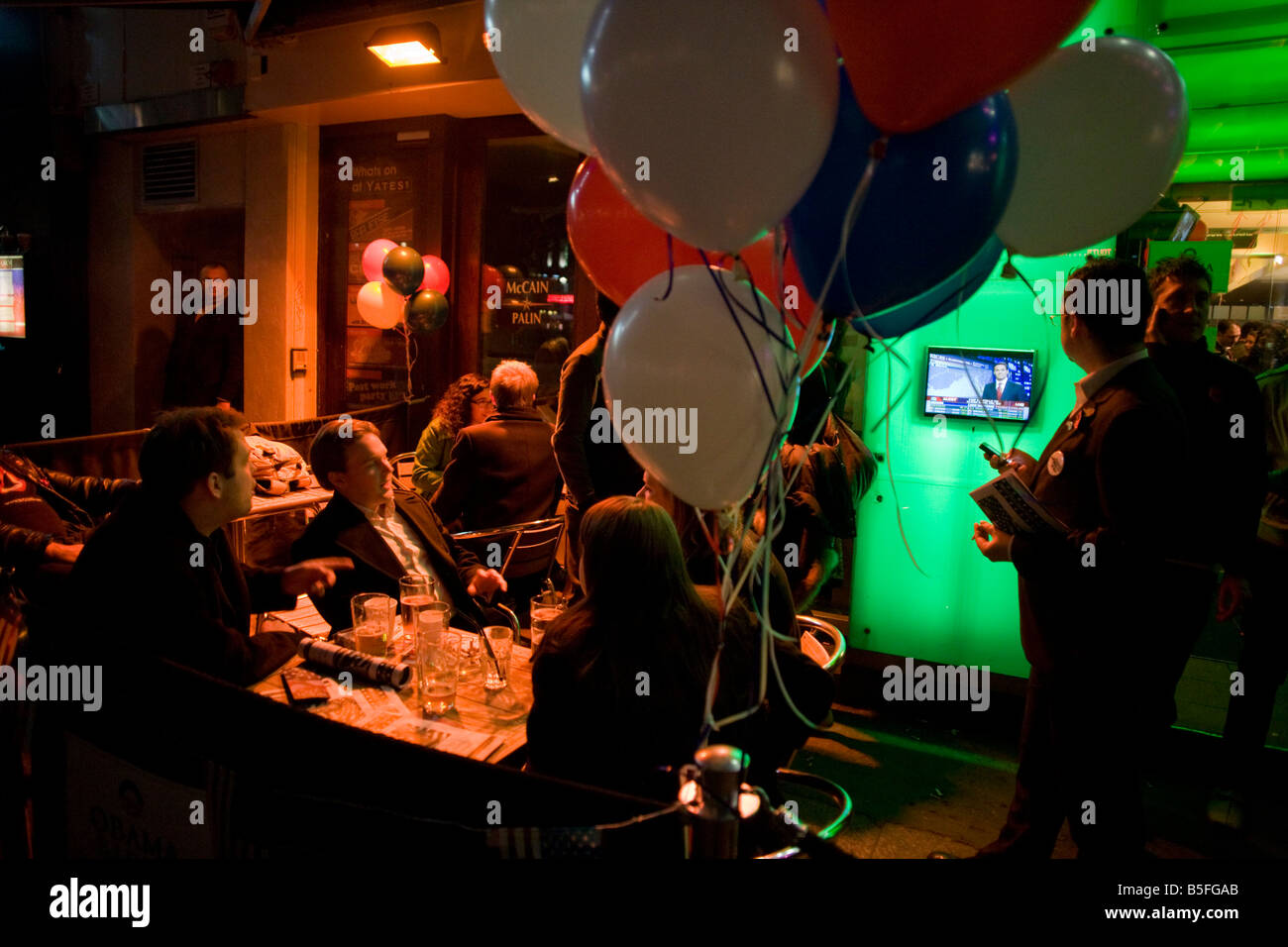 Guests of CNN watch outdoor TV during the 2008 political election which saw Barack Obama become the first black Stock Photo