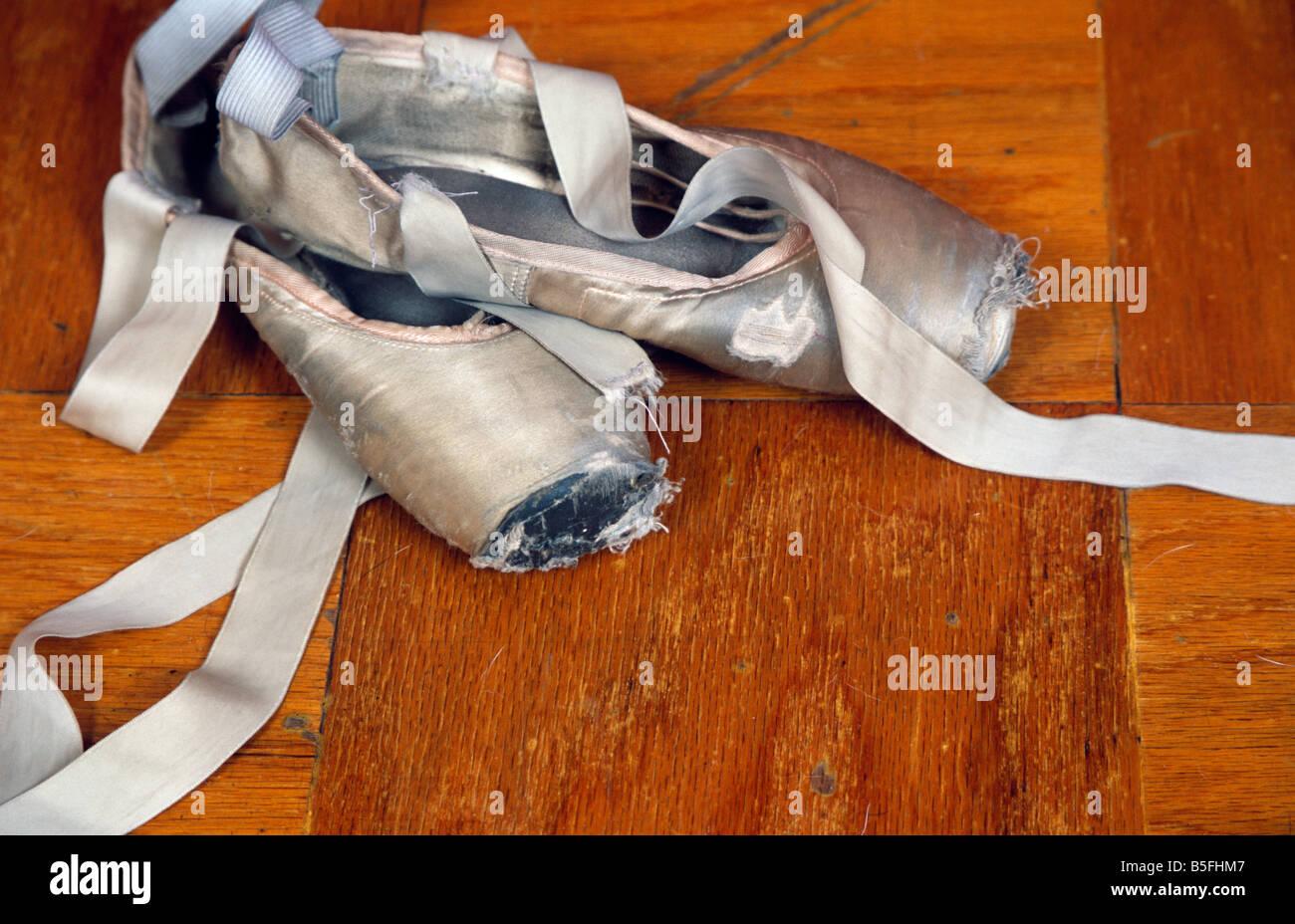 ballet point shoes on dance studio floor - Stock Image