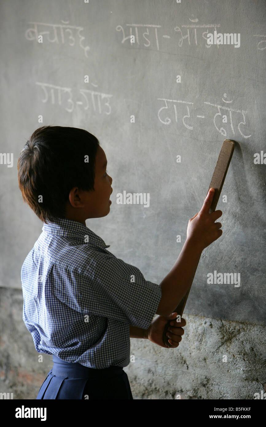 Nepal, girl on a blackboard, lesson in a village school in Jayamangala - Stock Image