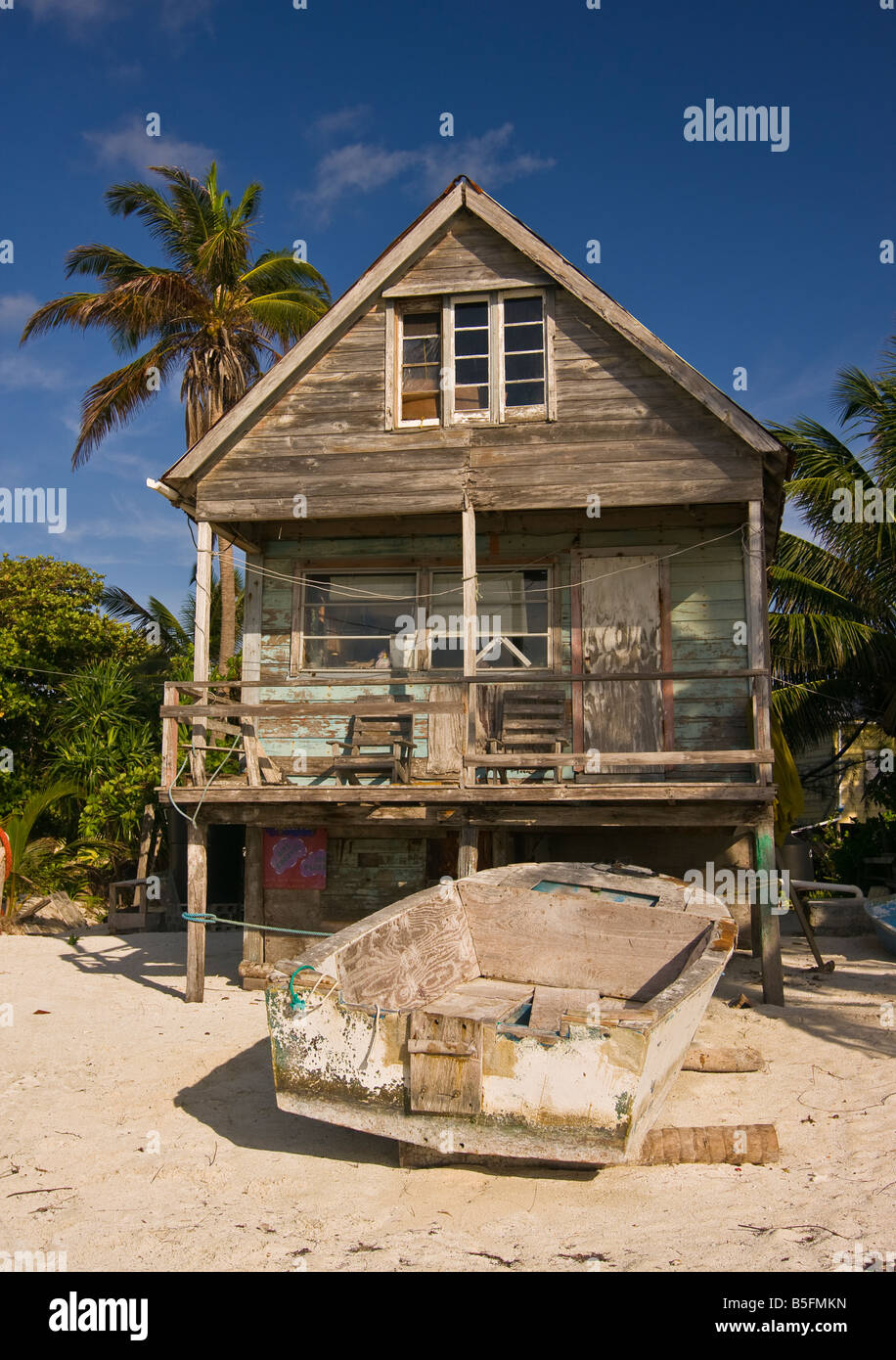 CAYE CAULKER BELIZE Old Wooden House On Stilts On Beach With Boat   Stock  Image