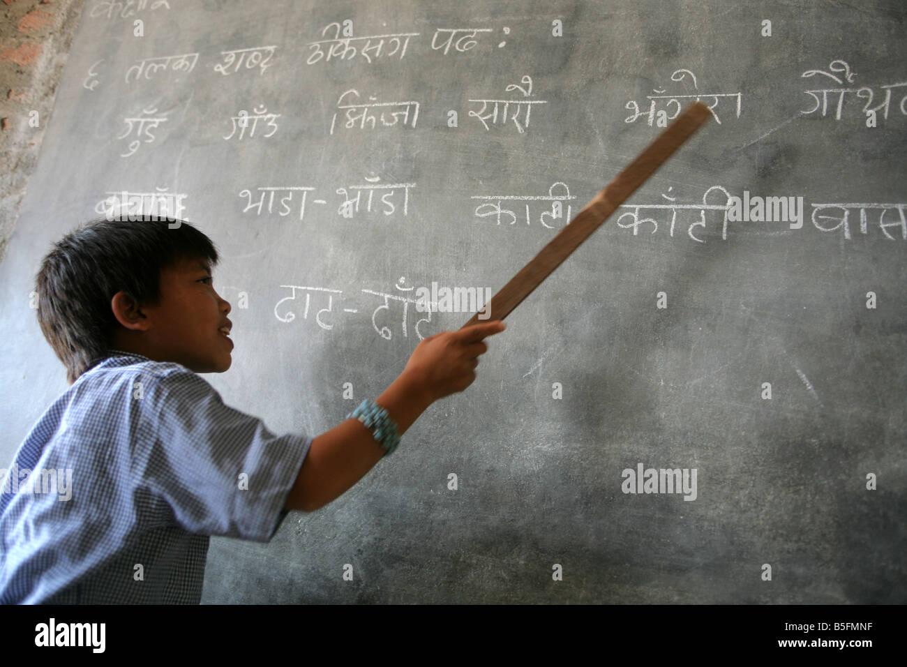 Nepal, boy on a blackboard, lesson in a village school in Jayamangala - Stock Image