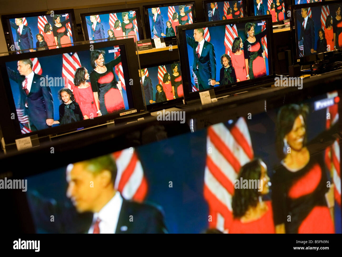 Barack Obama and family seen on BBC News TV screens in London's John Lewis department store after election victory - Stock Image