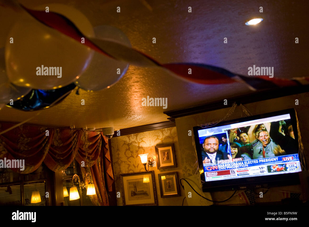 TV screen announces Barack Obama is declared Presidential election winner by CNN during overnight election party - Stock Image