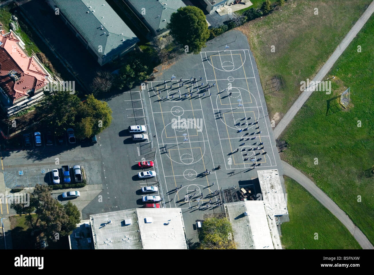 aerial view above children on school playground - Stock Image