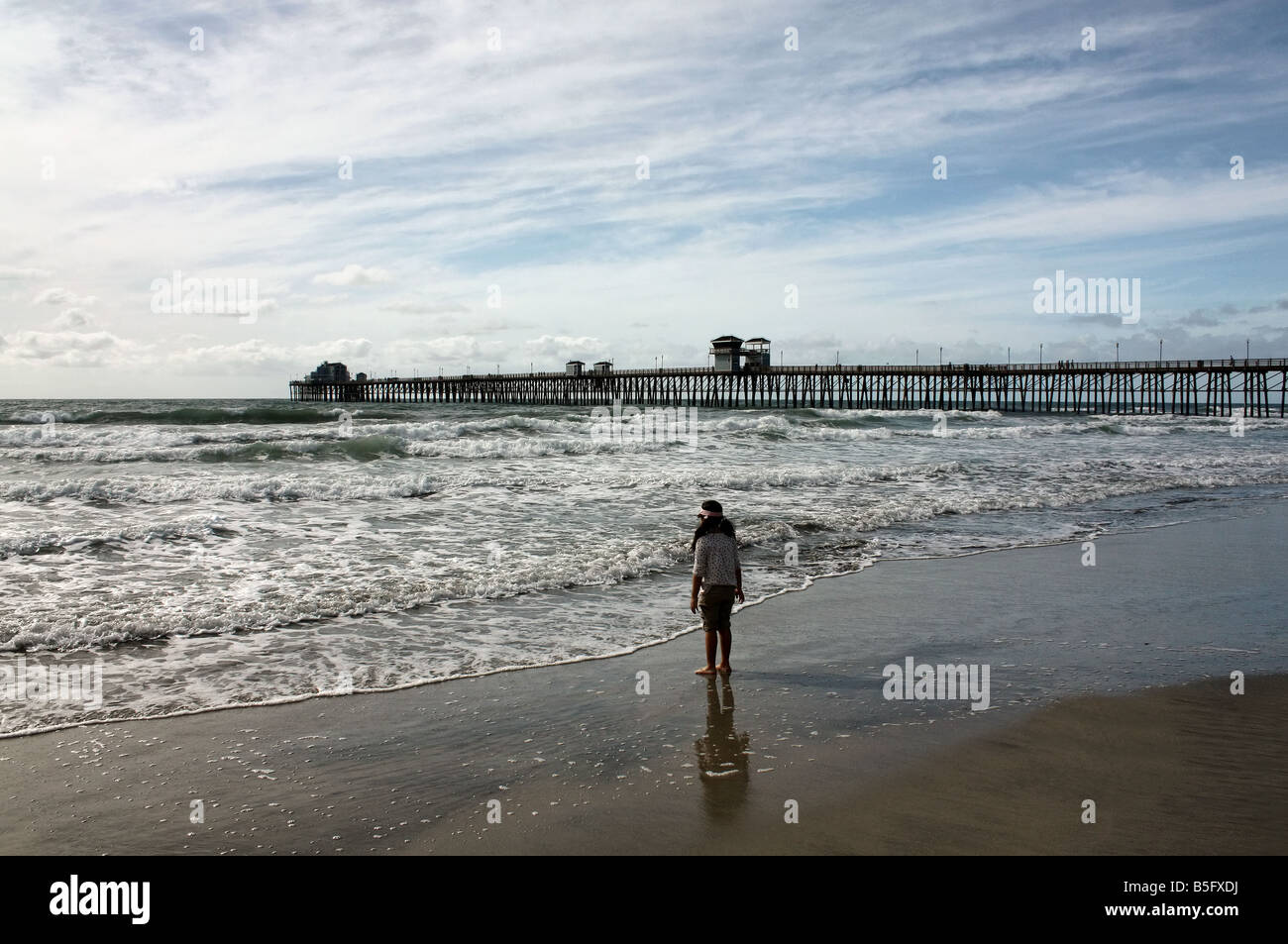 USA This young lady was captured on Oceanside Beach by the pier in Southern California - Stock Image