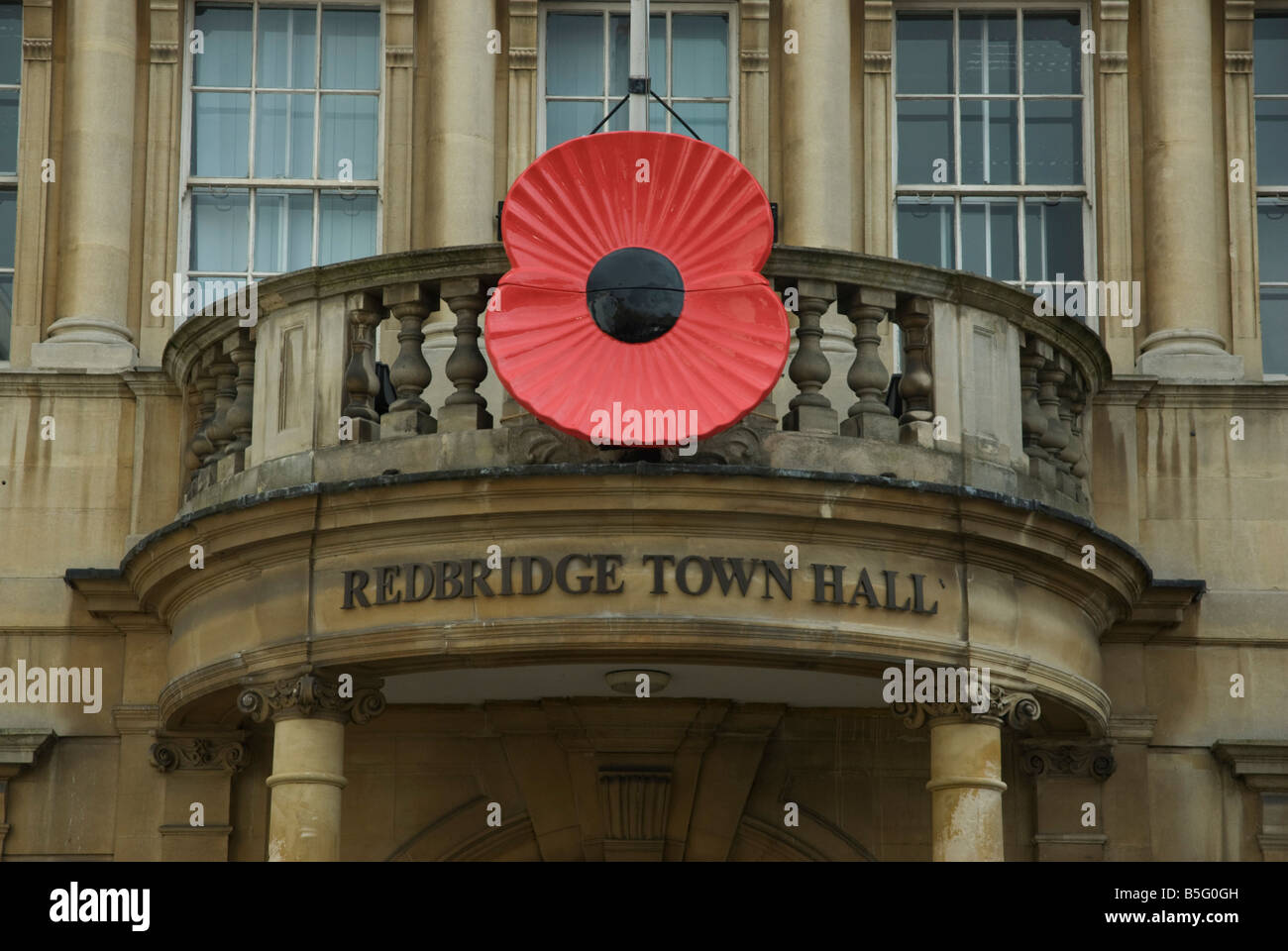 Redbridge Town Hall, Ilford Essex with large poppy - Stock Image