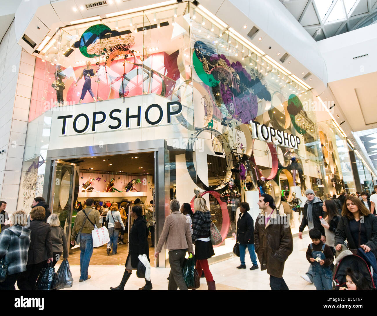 Shoppers ouside Topshop in Westfield shopping mall London - Stock Image