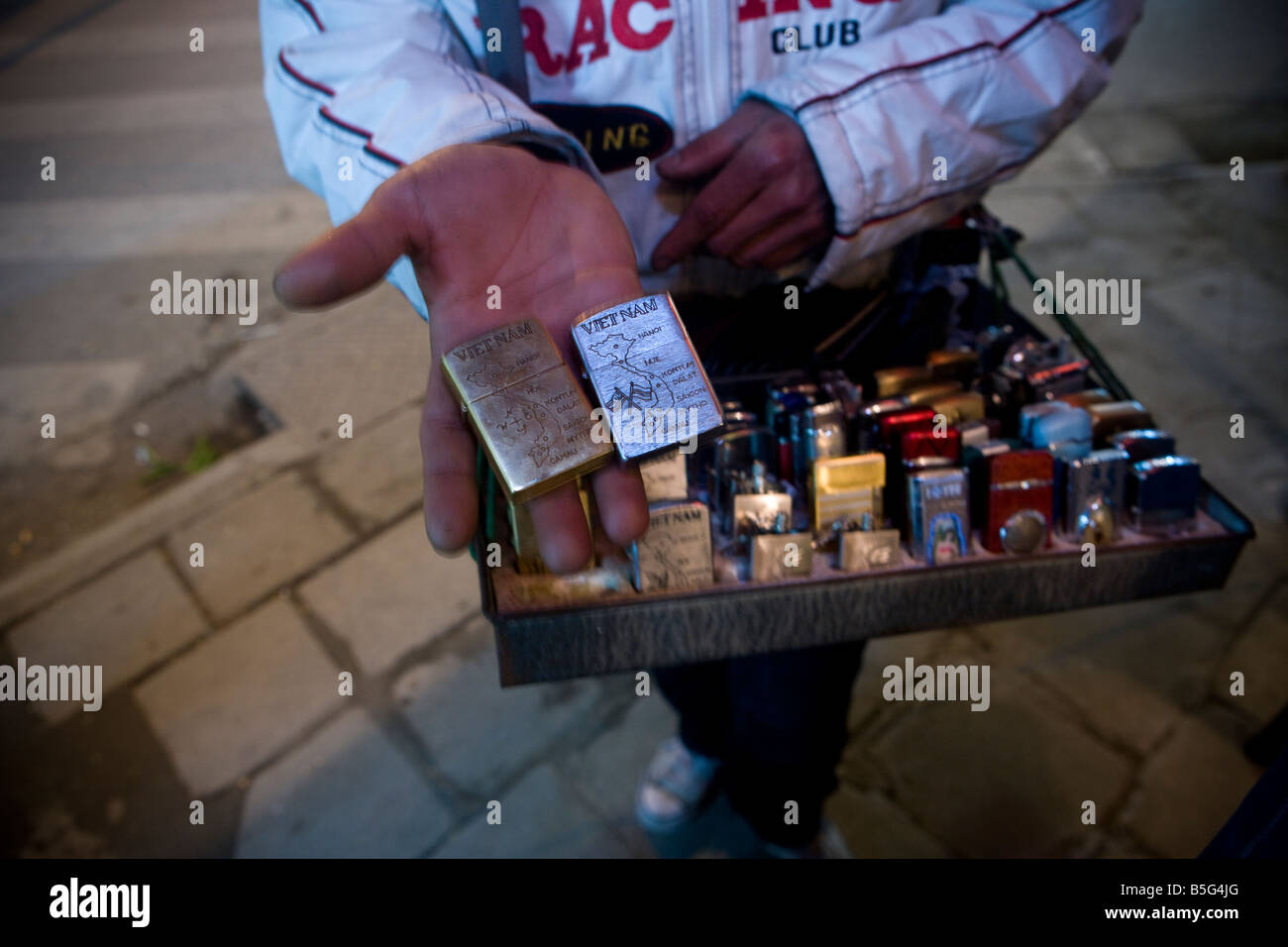 Street seller with Zippo lighters in central Hanoi VIetnam - Stock Image