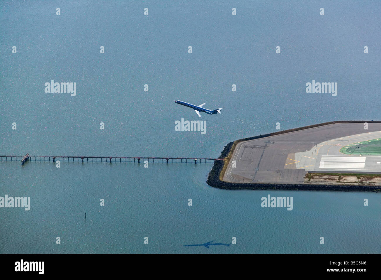 aerial view above passenger jet departing San Francisco international airport over instrument landing system approach - Stock Image