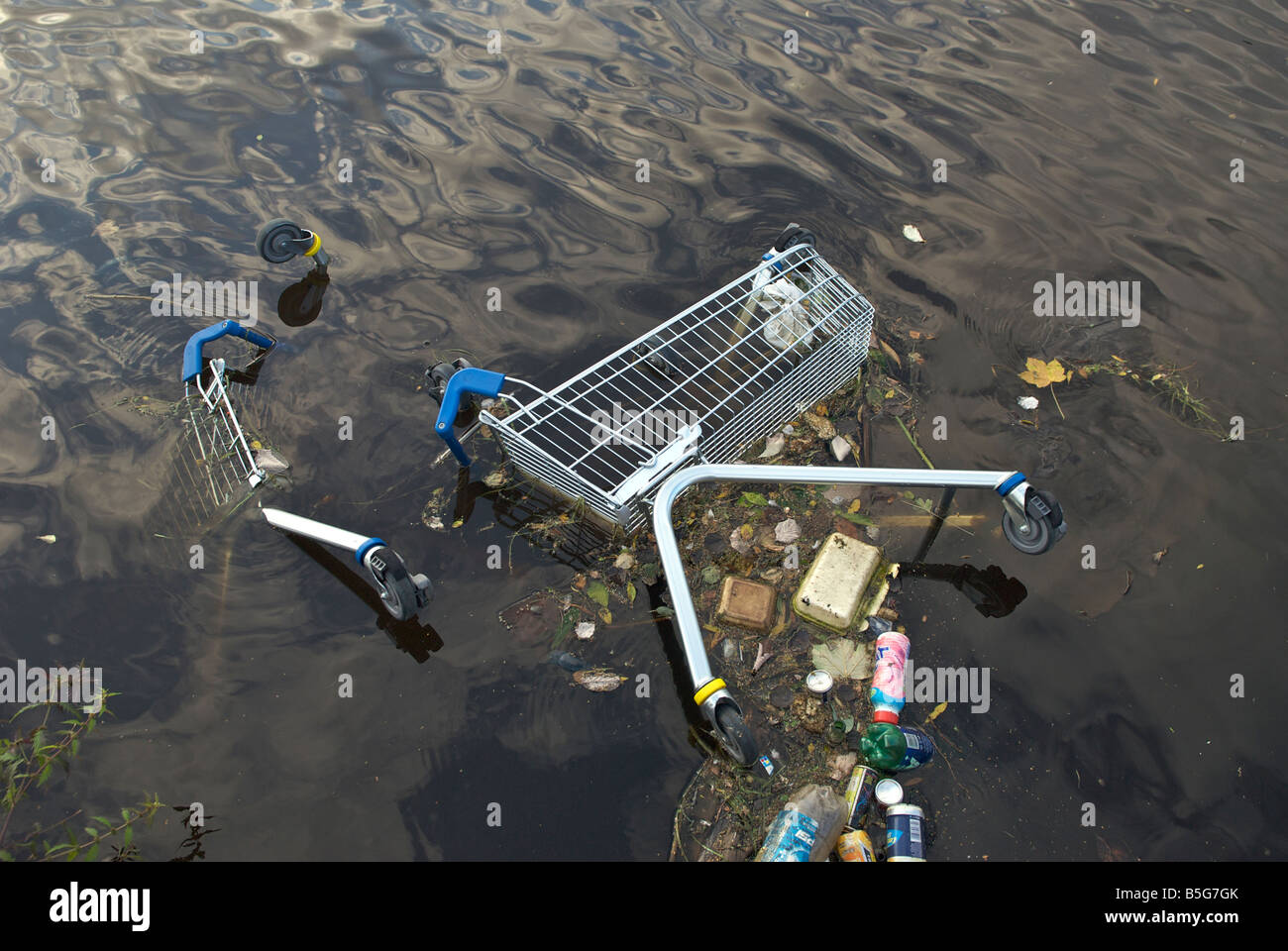 Tesco trolly dumped in a canal in Greater Manchester - Stock Image