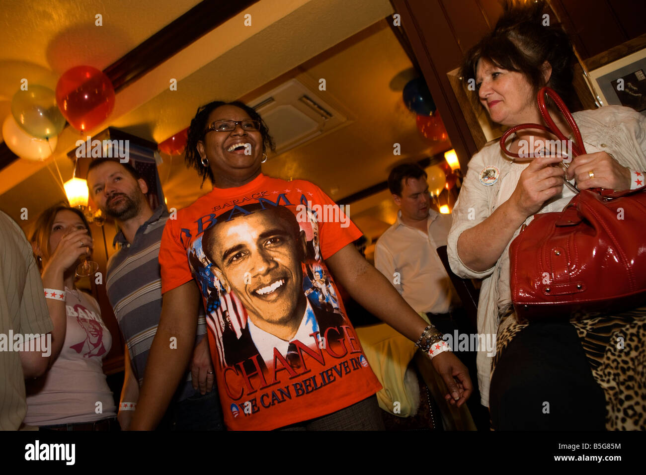 Expat Democrats celebrate as Barack Obama is declared Presidential winner by CNN during overnight election party - Stock Image