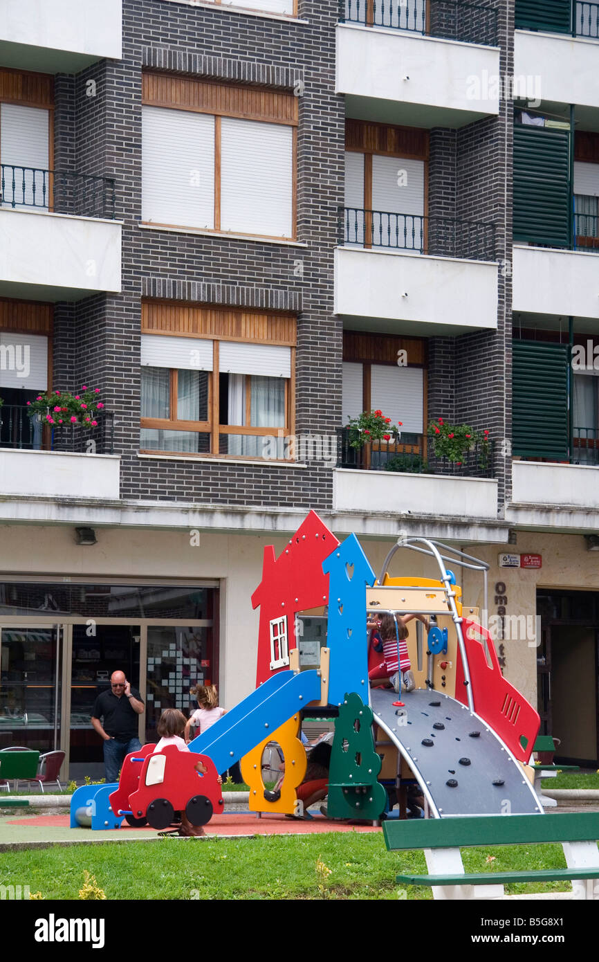 92685be8c01 Children use playground equipment in front of an apartment housing unit in  Guernica northern Spain