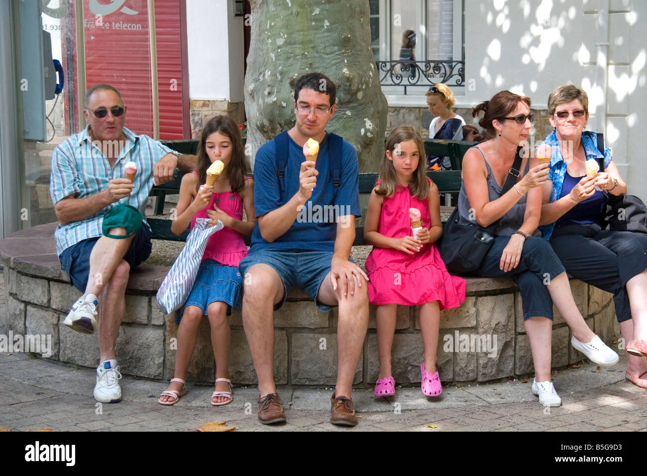 Family eating ice cream in the town of Saint Jean de Luz ...