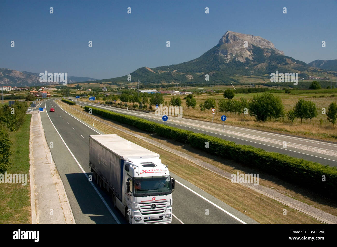 Long haul truck travels along the A 10 Autopista near the town of Etxarri Aranatz Navarre northern Spain - Stock Image