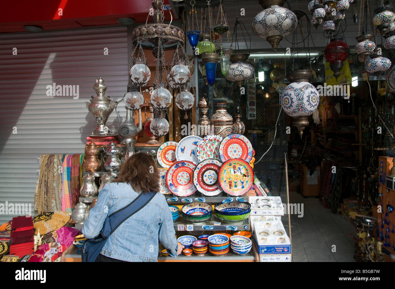 Turkey Istanbul Female tourist at a souvenir shop in Yeniceriler Caddesi Model Release available - Stock Image