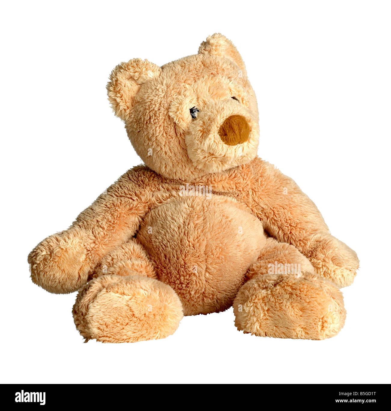 Tan teddy bear sitting Stuffed animal - Stock Image