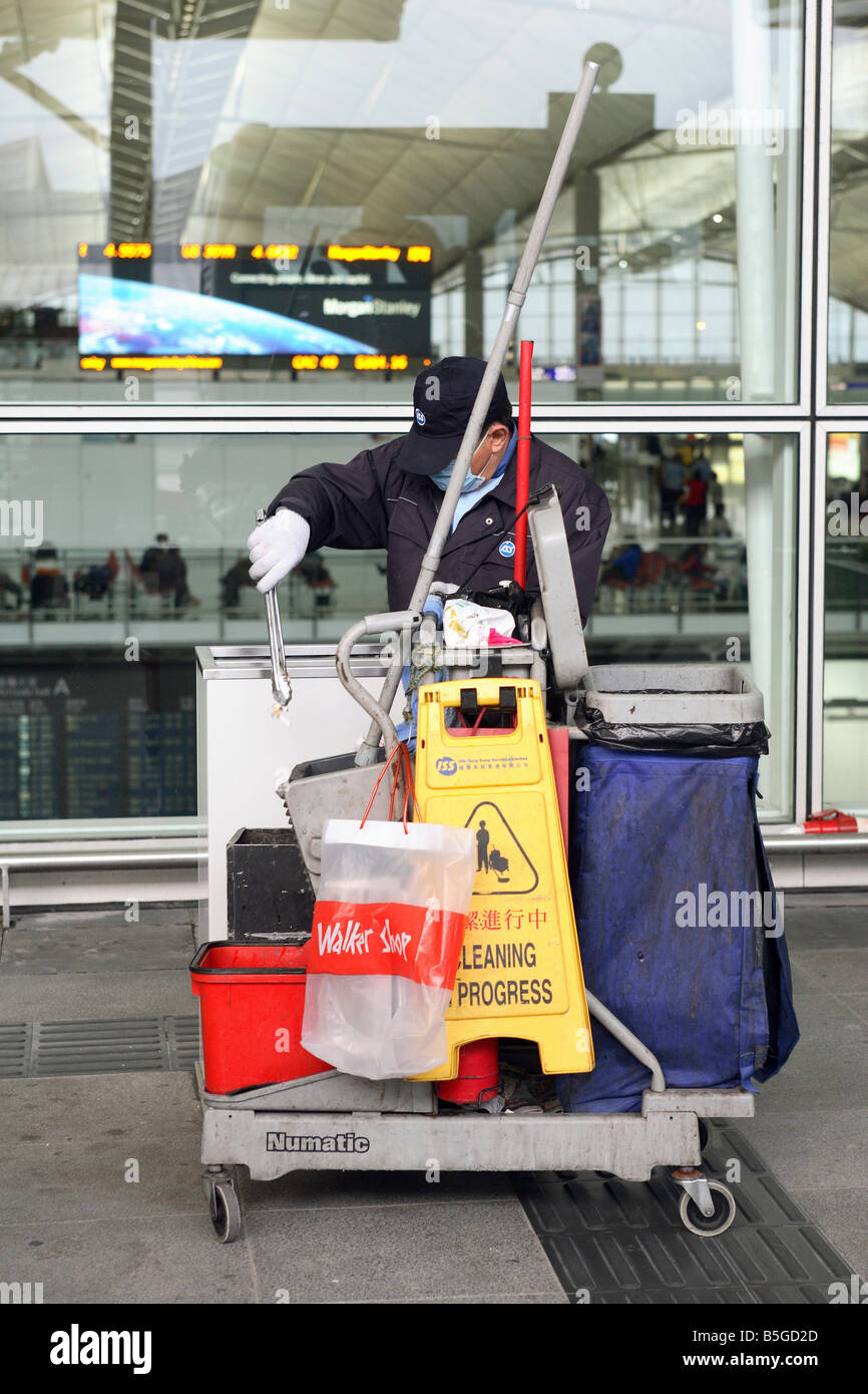 A cleaner working at the Chek Lap Kok Airport in Hong Kong, China - Stock Image