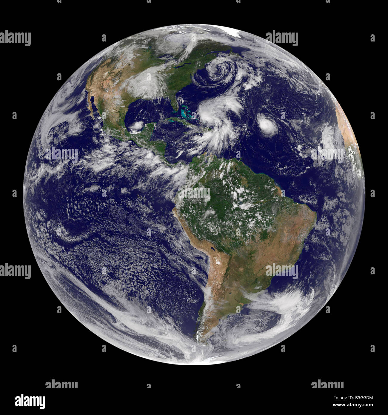 View of the full Earth and four storm systems. - Stock Image