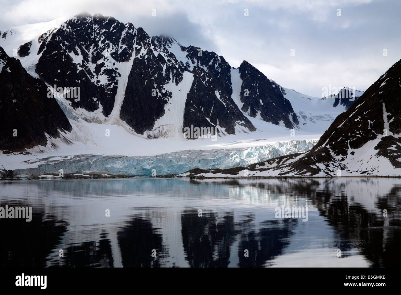 Spitsbergen Snowy Mountains Glacier Reflections - Stock Image