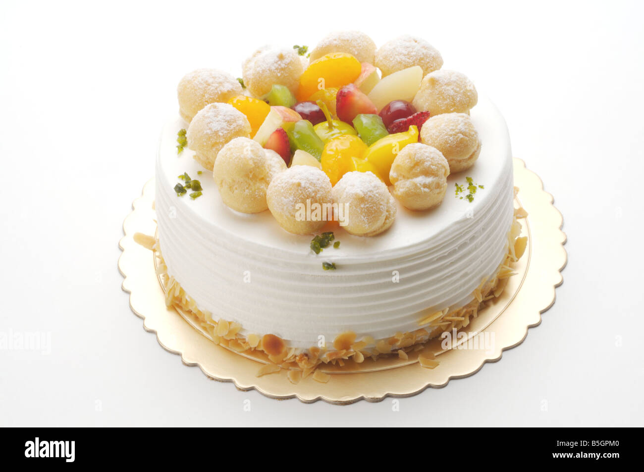 Birthday Cake With Fruit And Mini Cream Puffs On Top Stock Photo