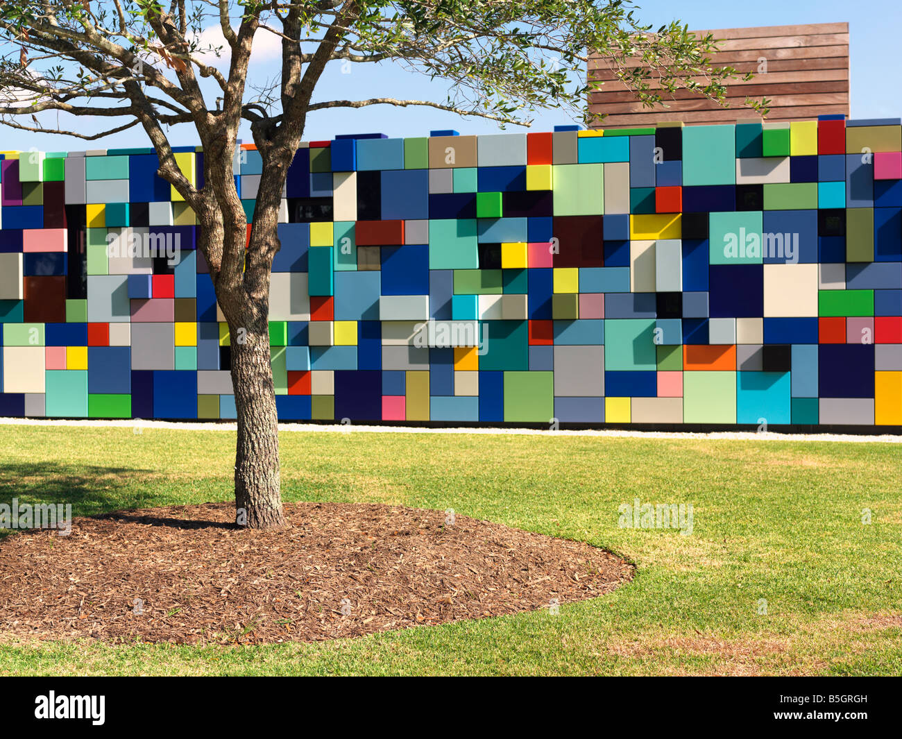 USA,Texas,Houston,colorful multi colored building used as entrance for parking garage at Discovery Park Synchronicity - Stock Image