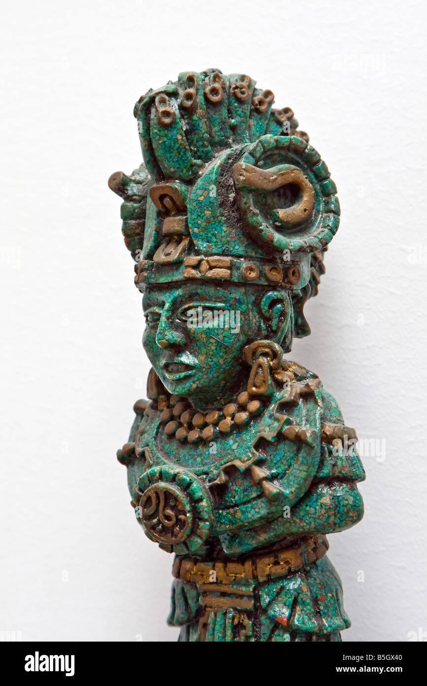 A statue figure of a decorated Maya warrior made of Jade stones isolated on white - Stock Image