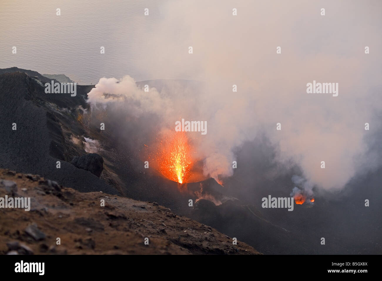 Stromboli's crater with an eruption from the NW vent - Stock Image