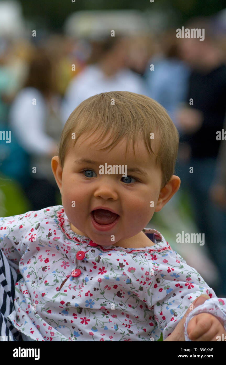 Baby Girl Child with Mouth Wide Open - Stock Image