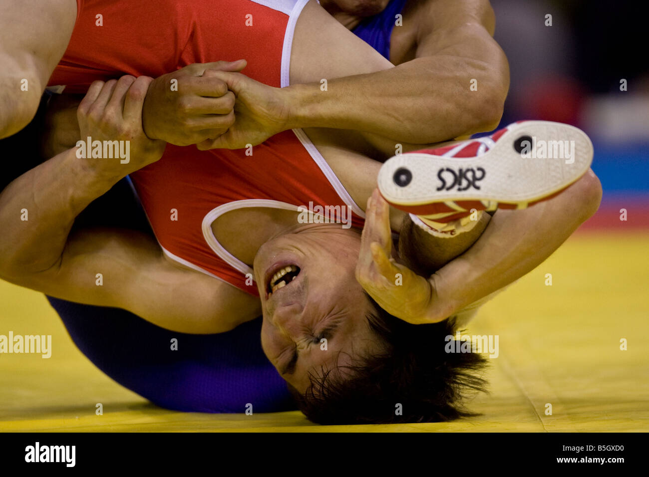 Kenichi Yumoto JPN L competing against Vitaly Koryakin TJK in the 60kg freestyle wrestling 1 8 final event at the - Stock Image