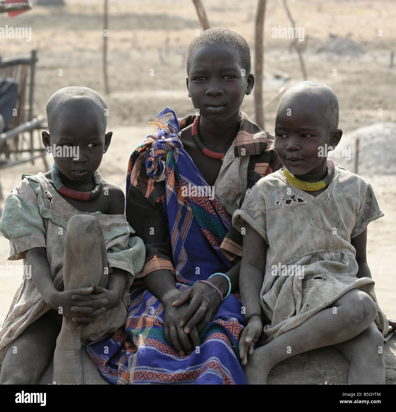 Dinka children growing up in a cattle camp near Akot, South Sudan - Stock Image