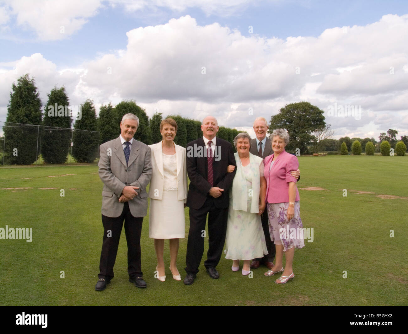 Staffordshire UK August Three married couples wedding guests - Stock Image