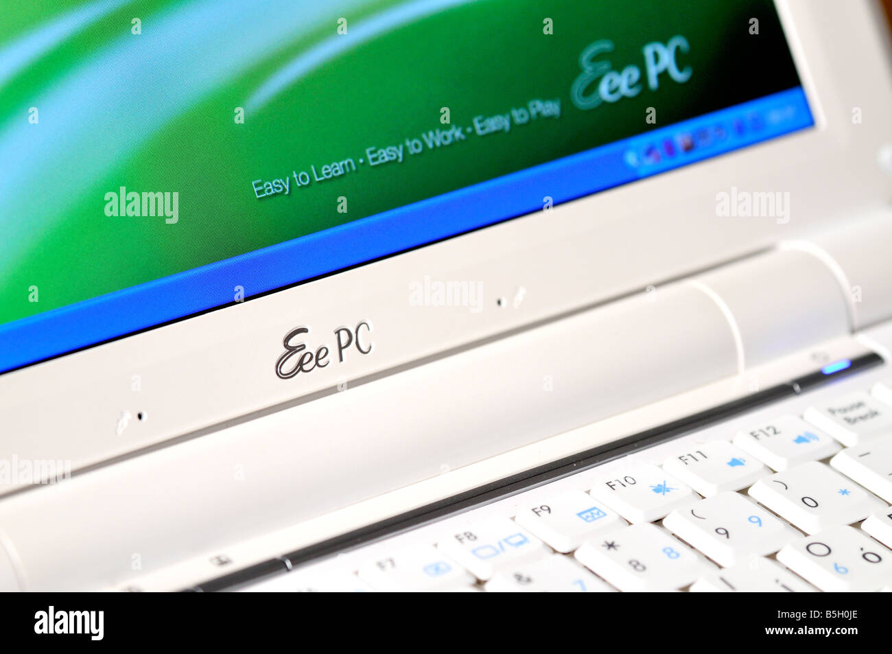 ASUS Eee PC closeup showing partial keyboard and screen - Stock Image