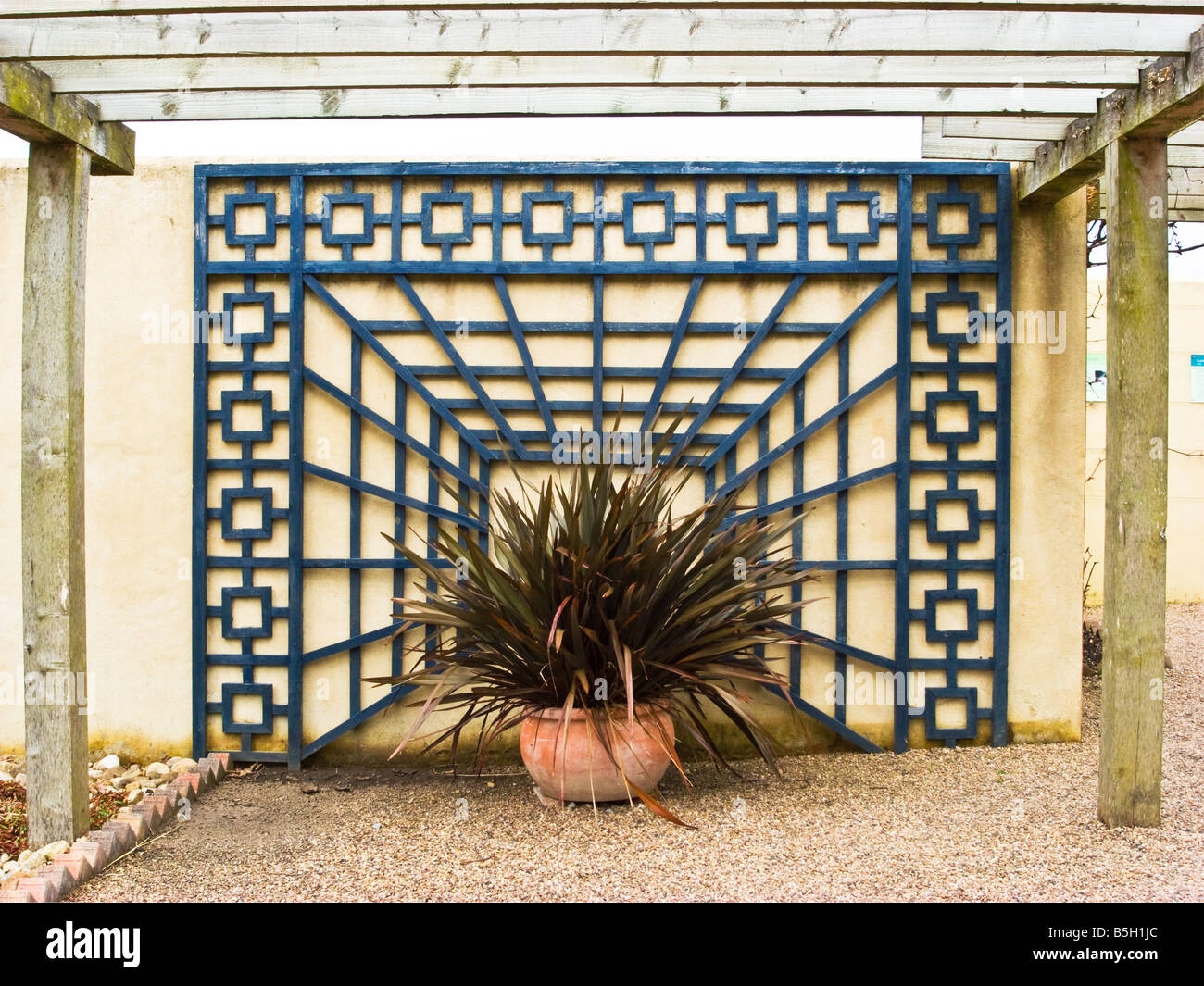 Garden design using ornamental trellis against a wall Stock