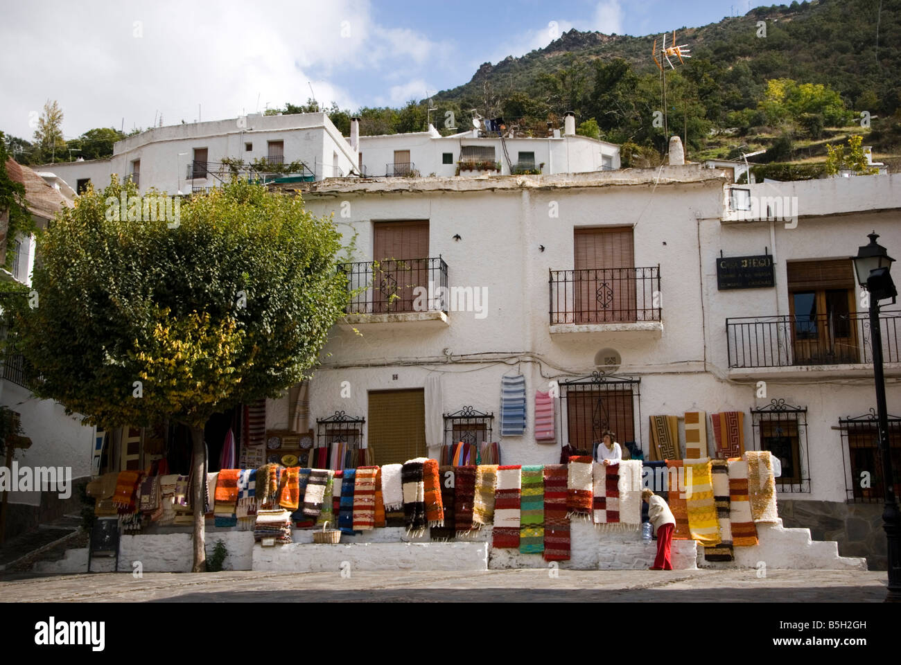 Locally made carpets and rugs for sale in Pampaneira village square in Sierra Nevada Southern Spain - Stock Image