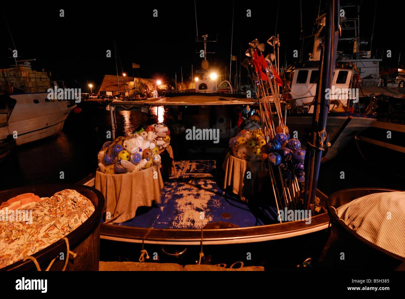 Night vision of fishing boats in the Civitavecchia harbour, Lazio, Italy Stock Photo