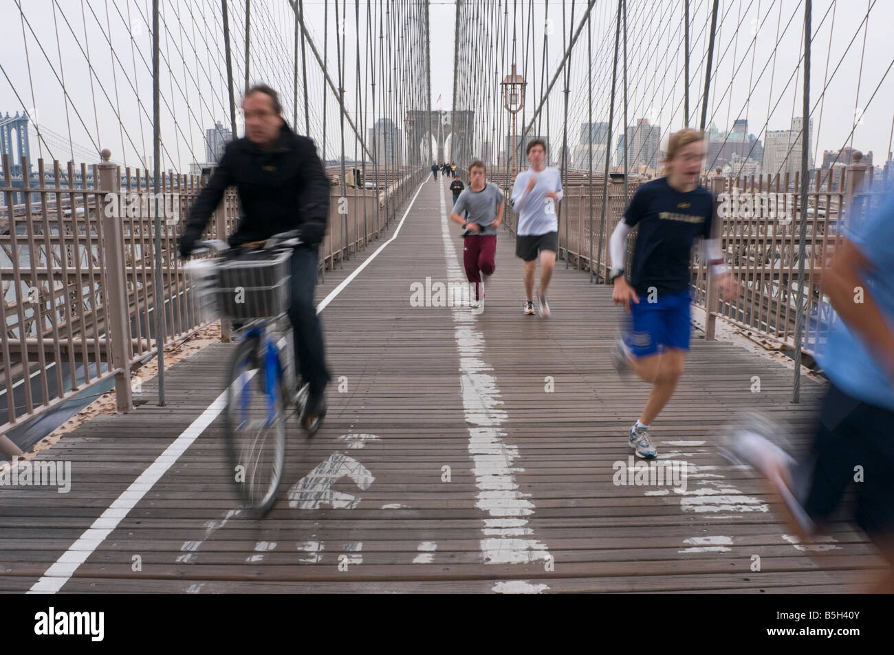 New York NY 3 November 2008 Joggers and cyclists on the pedestrian path of the Brooklyn Bridge Stock Photo