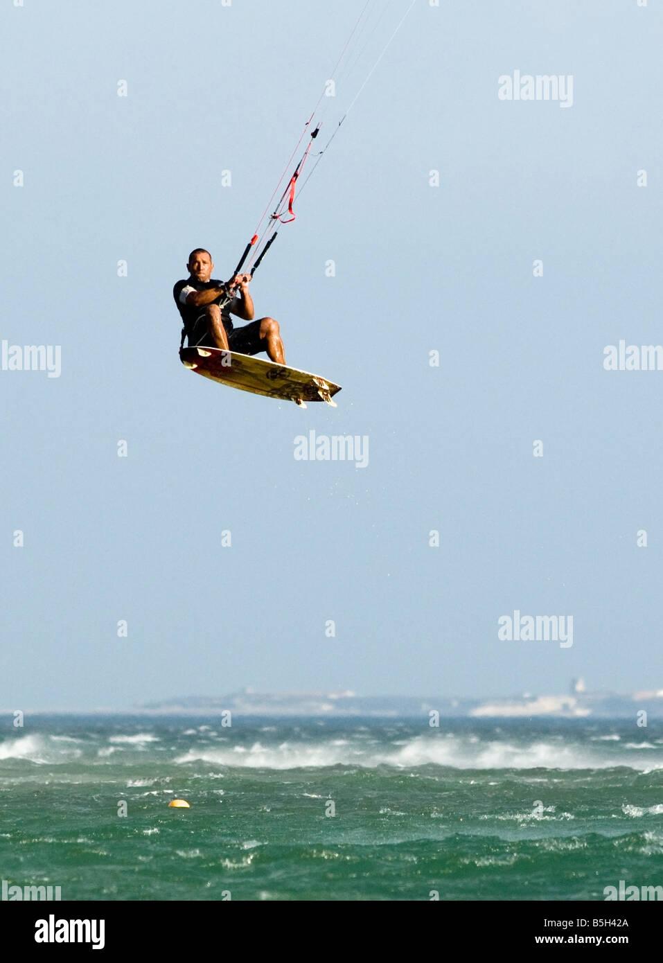 high jump by a kitesurfer - Stock Image